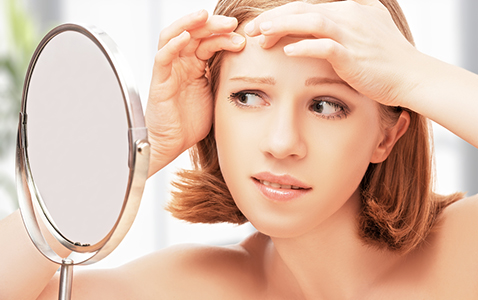 Woman Frightened Saw in the Mirror Acne, Acne Treatment in FL